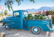 Old Truck Parked Next To Highway Route 62 In Western Cape South Africa With Vegetables And Fruit - Watermelons And Pumpkins