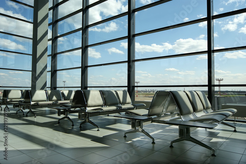 Foto op Aluminium Luchthaven Airport gates, modern architecture of the airport terminal with seats and a huge glass facade of view
