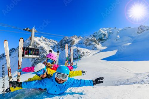 Fotobehang Wintersporten Happy family enjoying winter vacations in mountains . Ski, Sun, Snow and fun.