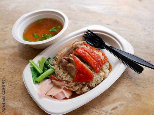 Photo roasted duck over stream rice with soup on bagasse dish
