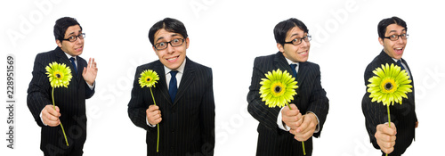 Valokuva Young man in black costume with flower isolated on white
