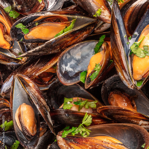 Closeup of cooked mussels, shot from above