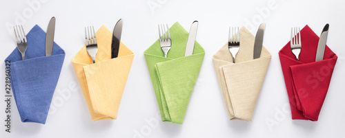 Photo  knife and fork in folded napkin