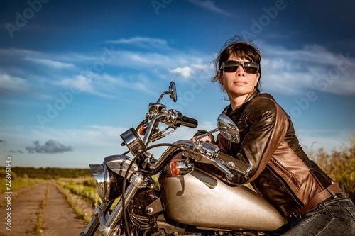 Canvas Prints Fishing Biker girl sitting on motorcycle