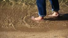 Bare Foot Man Walking On Tahoe Shoreline In Rolled Up Jeans