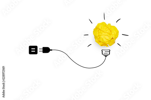 Creative idea, Inspiration, New idea and Innovation concept with Yellow crumpled paper light bulb, Wires and plugs, white background.