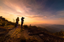 Two Photographers Take A Picture Of The Sunrise At Doi Inthanon, Chiang Mai, Thailand.