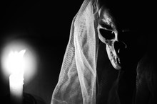 Bride Skull With Face Cover And Candle Light Nearby For Your Posters Or Halloween Festivities.