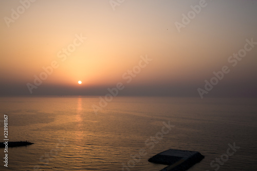 Fotografie, Obraz  Panoramic view of sunset and helipad (landing area or platform for helicopters) in the Indian ocean