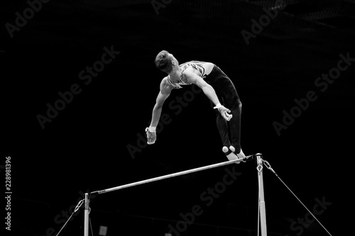 exercise on horizontal bars athlete gymnast black and white photo