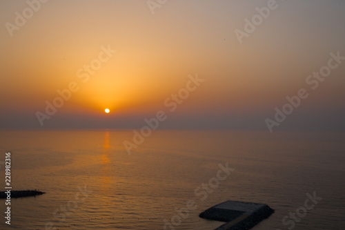 Fotografia, Obraz  Panoramic view of sunset and helipad (landing area or platform for helicopters) in the Indian ocean