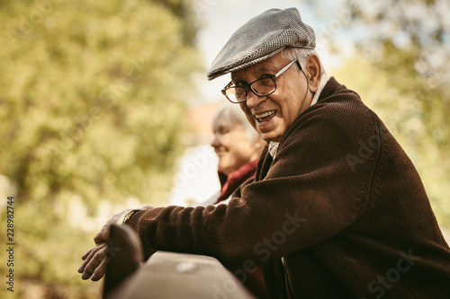 Smiling old man at park on a winter day