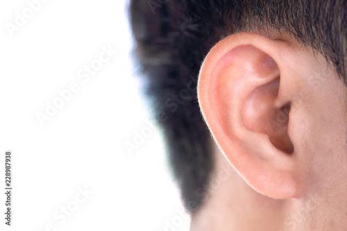 Billede på lærred Close up man's ear on white background