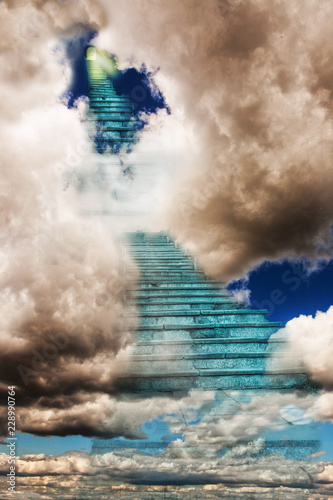 Heavenly Staircase leading up though the clouds to a door with a light shining t Fototapet