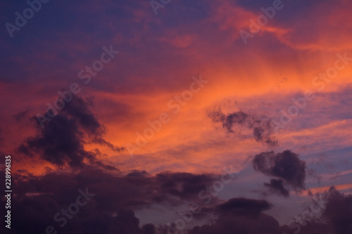 Foto op Aluminium Crimson Sky with purple and orange cloudy sunset
