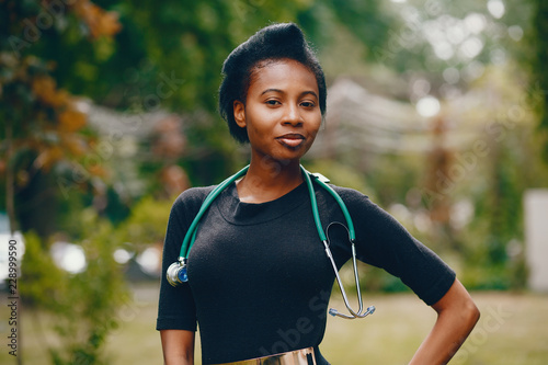 Foto  Black girl with stethoscope
