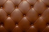Fototapeta Sypialnia - Brown genuine leather sofa background.
