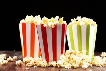 Fototapeta Cinema concept with popcorn in green white bag.