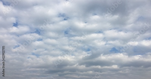 Canvas Prints Heaven Beauty cloud against a blue sky background. Sky slouds. Blue sky with cloudy weather, nature cloud. White clouds, blue sky and sun.