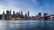 4k cinemagraph of New York City Manhattan, financial district skyline, cityscape at Brooklyn bridge park during sunset, dusk, night, twilight, skyscrapers, moving traffic, cars, light streaks