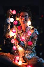 Happy Woman Wearing Glowing Ja...