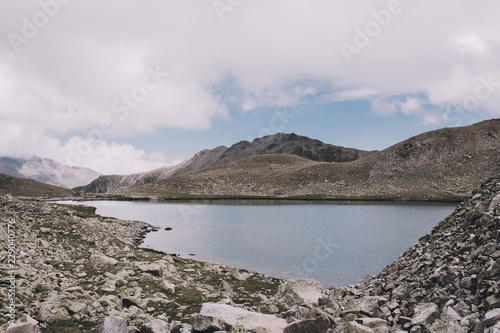 Lake scenes in mountains, national park Dombai, Caucasus, Russia, Europe. Summer landscape, sunshine weather, dramatic blue color sky and sunny day