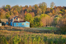 Small Rustic Home With Adjoining Vegetable Garden In Autumn Time. Rural Life. Ukraine.