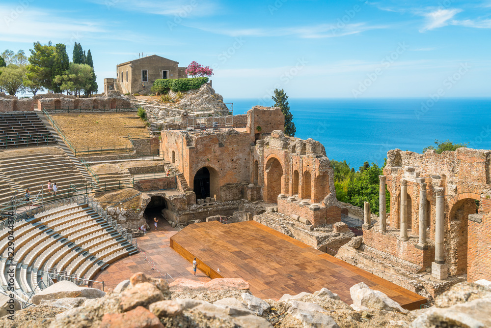 Fototapety, obrazy: Ruins of the Ancient Greek Theater in Taormina on a sunny summer day with the mediterranean sea. Province of Messina, Sicily, southern Italy.