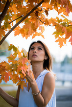 Girl By Autumn Tree
