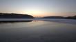 Stado łabędzi na jeziorze o zachodzie słońca II