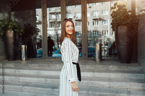 29f96b8b737 Summer sunny lifestyle fashion portrait of young stylish hipster woman with  sunglasses walking on the street