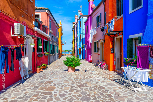Fototapeta Street with colorful buildings in Burano island, Venice, Italy