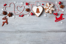 Christmas Wooden Background With Gingerbread, Anise, Decor, Snowflakes And Red Berries