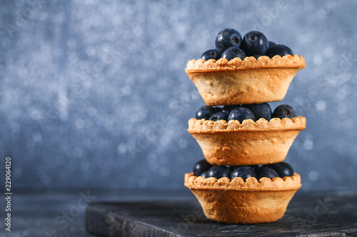 Blue blackthorn berries in sand tartlets on a table. Tapéta, Fotótapéta