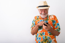 Happy Senior Bearded Tourist Man Smiling And Giggling While Using Phone