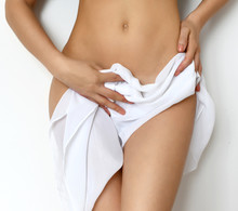 Body Care Gynecology And Woman's Health. Close Up Photo Of Woman Hold Soft  Towel Near Intimate Part Of Her Abdomen