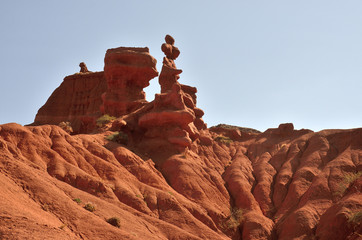 Red pinnacles of sandstone rocks of Konorchek gorge,Kyrgyzian Grand Canyon,famous natural landmark and hiking place,Issyk-Kul lake region,Central Asia