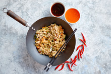 Delicious Fried Rice With Chicken. Prepared And Served In A Wok With Soy And Sweet Sour Souces On Side. Placed On Stone Background. Top View.