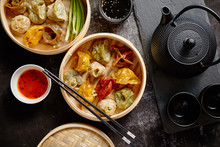 Oriental Traditional Chinese Dumplings Served In The Wooden Steamer Placed Dark Rustic Background. Top View Composition.