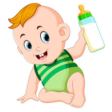 The Cute Baby Playing And Hold The Milk Bottle