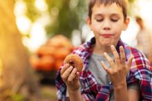 Boy Eating Apple Donut On The ...