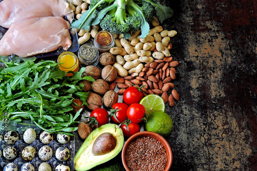 Fototapety, obrazy: A set of healthy products for diet food. Superfoods Products useful for influencing the body. Vegetables, nuts, quail eggs, greens, chicken meat. Products containing vitamins and trace elements.