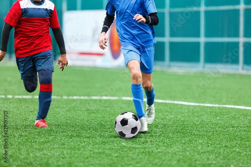 Fotografía  Children are kicking soccer classic white and black ball