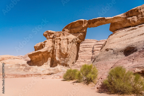 Scenic view of Um Fruth rock arch in Wadi Rum desert, Jordan.