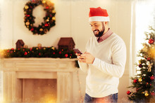 Waiting For Guests. Cheerful Handsome Bearded Man Standing Near Decorated Fireplace In His Apartment Waiting For Guests