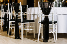 Decorated Chairs With Black Fa...
