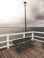 Wooden pier on the cloudy day
