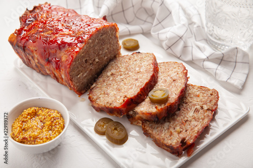 Photo Bacon Wrapped Ground Beef Meatloaf with Cabbage and Bulgur