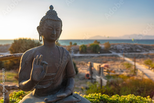 Sunset Over Representation Of Sitting Protection Buddha