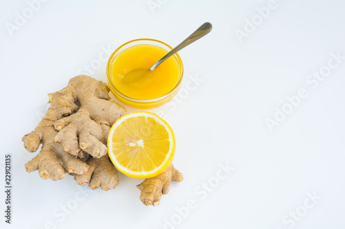 Photo  Ingredients for natural tea with ginger, lemon and honey on white background